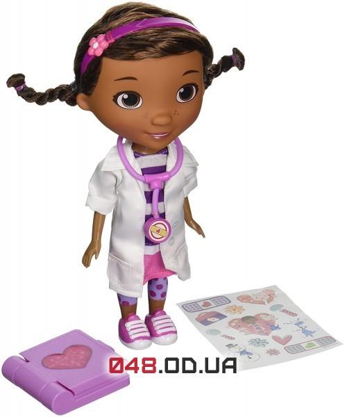 Кукла  доктор Плюшева Дисней + большая книжка с наклейками, 22 см.
